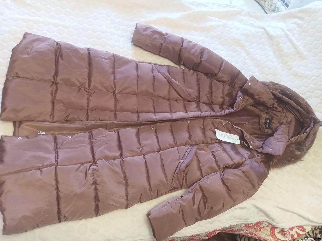 Женское пальто-пуховик стёганое.